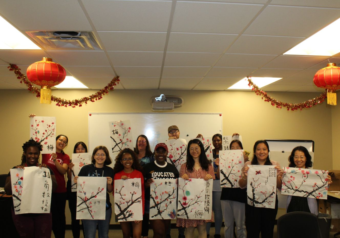 The students pose with their new artwork in a group picture.