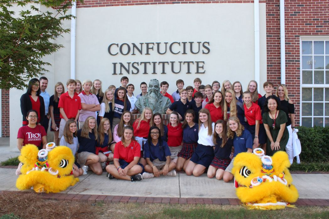 The students of Trinity Presbyterian Middle pose with the Confucius bust at CIT.
