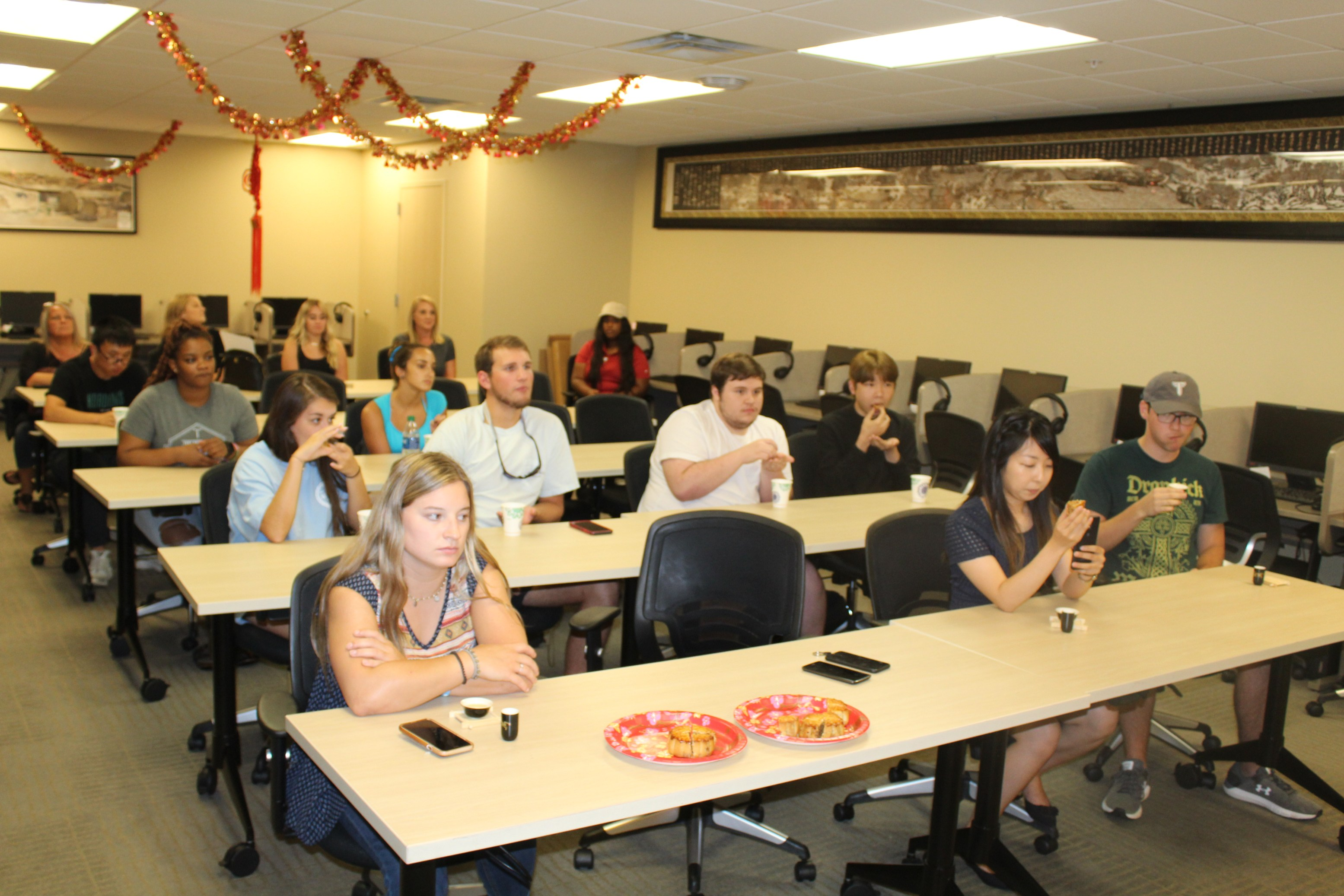 Troy students try Chinese tea and learn about etiquette.