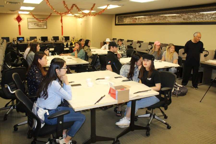 Troy students paid close attention to the visiting scholar instruction on how to draw Chinese painting