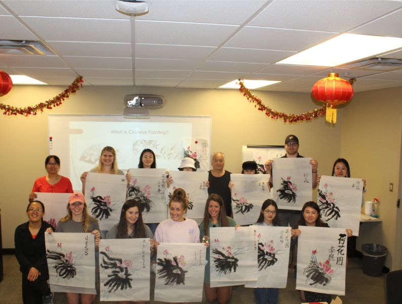 students proudly presented their Chinese paintings