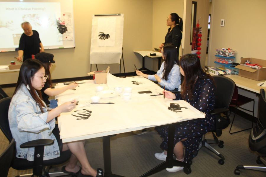 students were working on their Chinese painting after the visiting scholar instruction