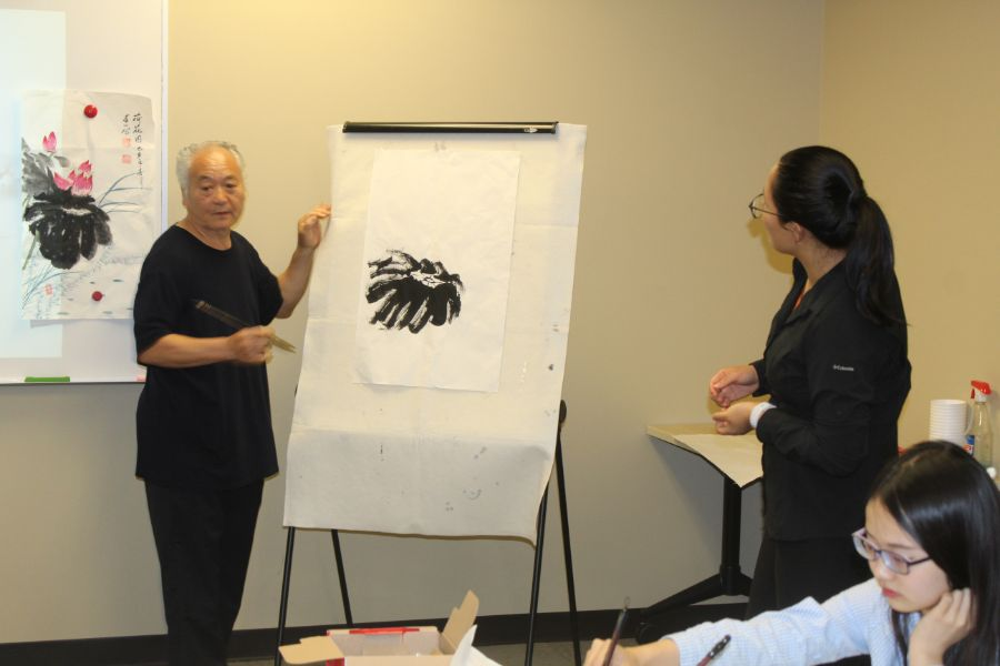 visiting scholar instructed Troy students on how to draw Chinese painting
