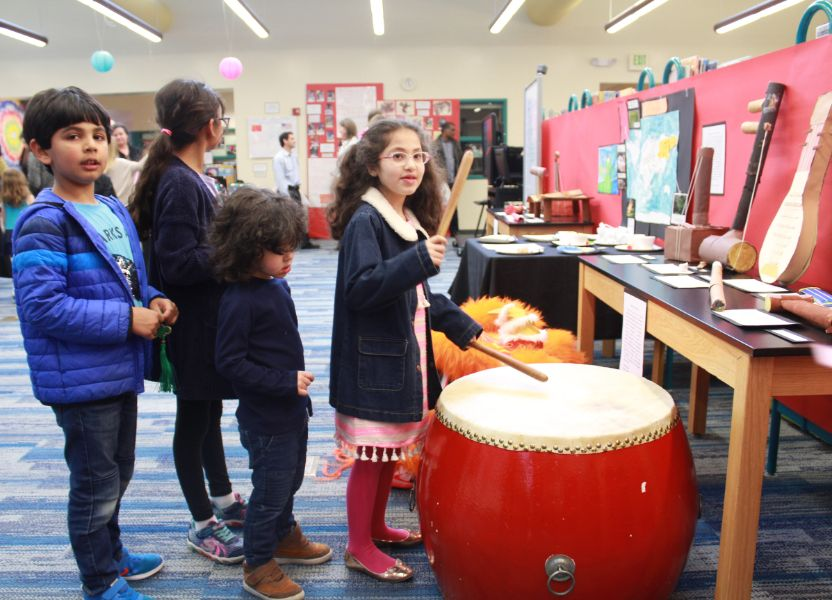 children lined up to play Chinese drum