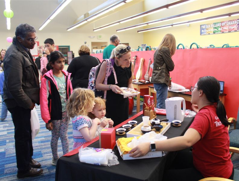 families interested in Chinese culture at the event