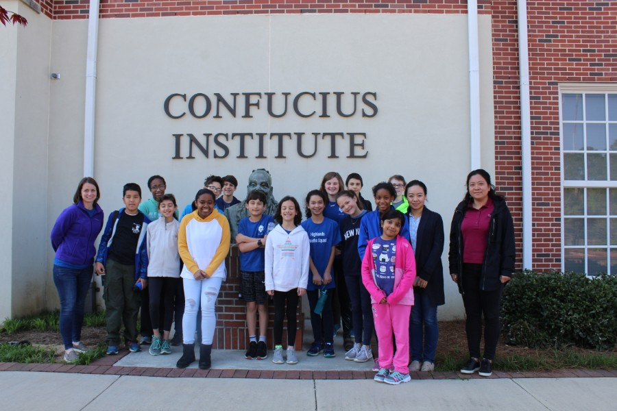students took picture in front of Confucius Institute