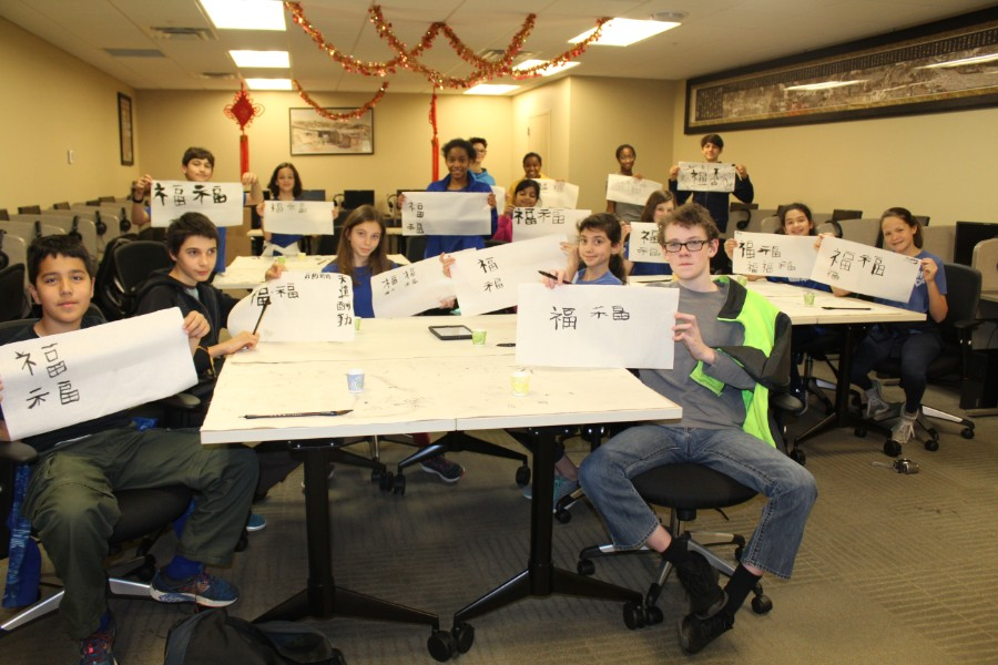 students proudly presented their caligraphy works