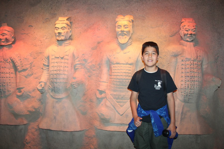 a student took picture with the terra cotta warriors