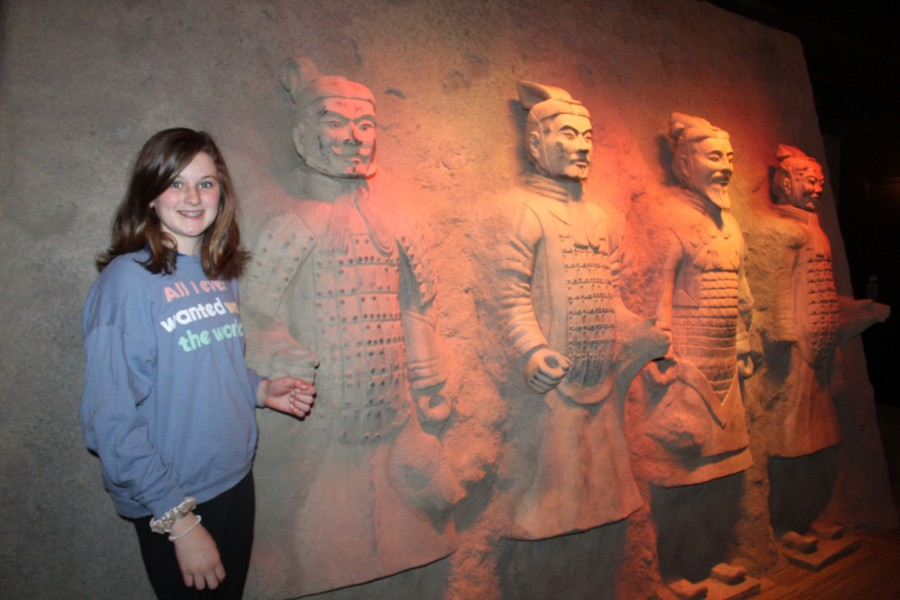 student took picture with terra cotta wariors