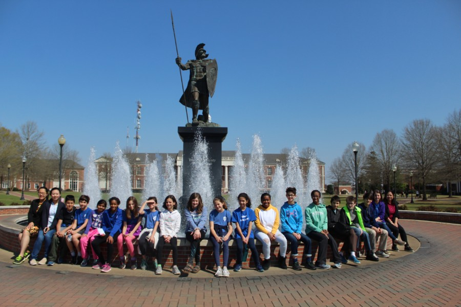students took pictures at the fountain of Troy University
