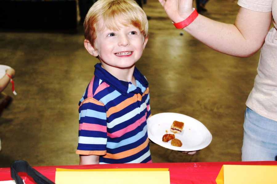 a boy interested in chinese food at the event