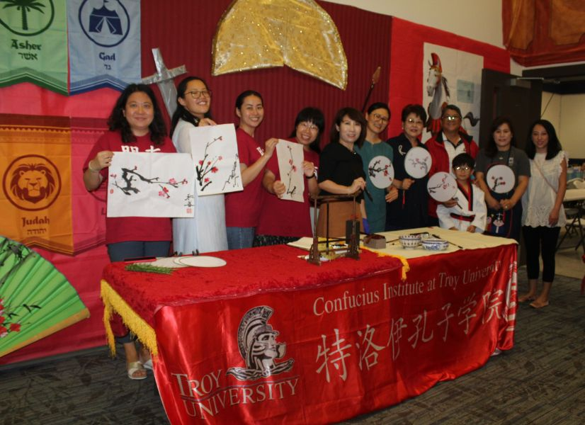 CIT staffs cheerfully showed their paintings.