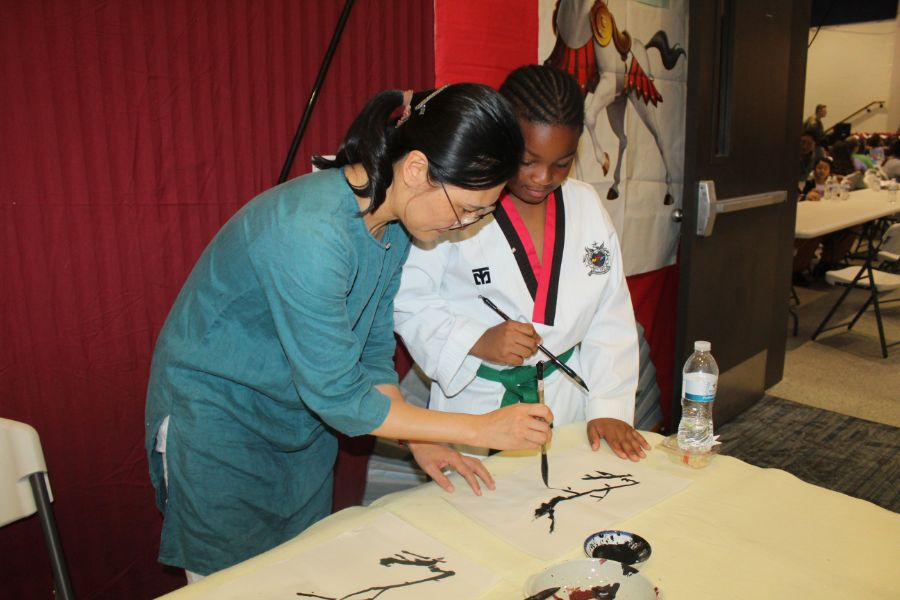 CIT staff instructed a student about Chinese calligraphy painting.