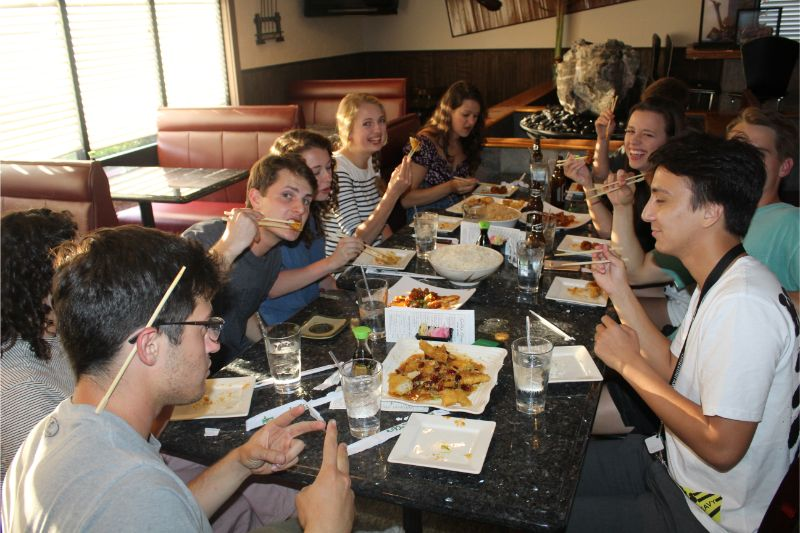 The students enjoyed the Chinese food at the reunion dinner
