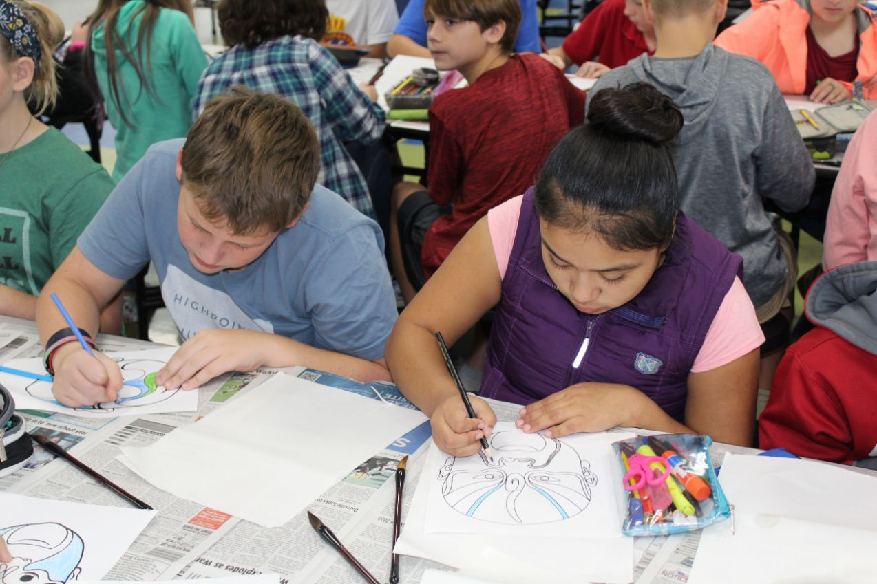 At Holly Hill Elementary School, the students color their own opera masks.
