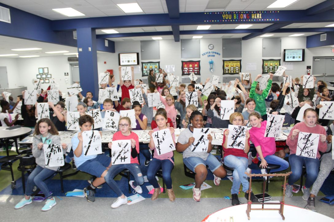The Holly Hill students pose again, this time with their traditional Chinese paintings.