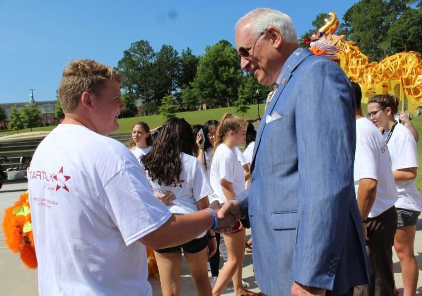 dr. hawkins shook hand with one of the students