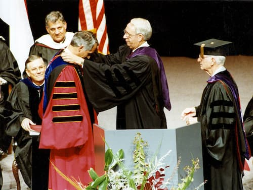 Alabama Gov. Guy Hunt drapes the Chancellor's Medallion around the neck of Dr. Jack Hawkins, Jr. during inauguration ceremonies in 1989, with former Chancellor Dr. Ralph Adams, right, assisting.