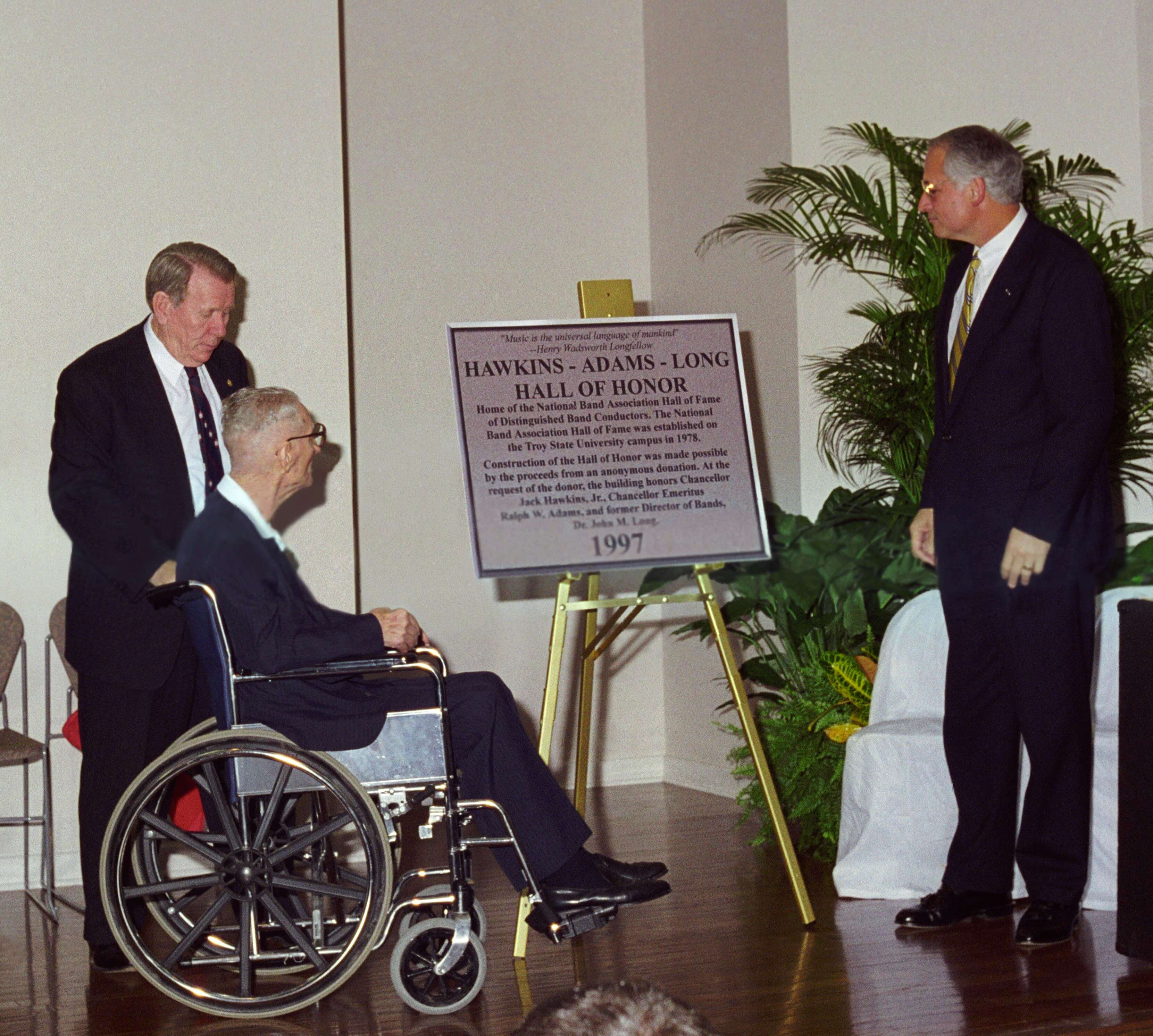 (from left) Dr. John M. Long, Dr. Ralph Wyatt Adams and Dr. Jack Hawkins, Jr., read the dedicatory plaque during ceremonies at the new Hawkins-Adams-Long Hall of Honor in 1997.