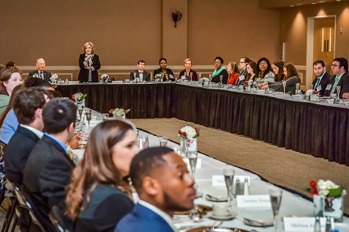 TROY First Lady Janice Hawkins hosts an etiquette luncheon to help prepare students in TROY's leadership classes for professional and social settings.