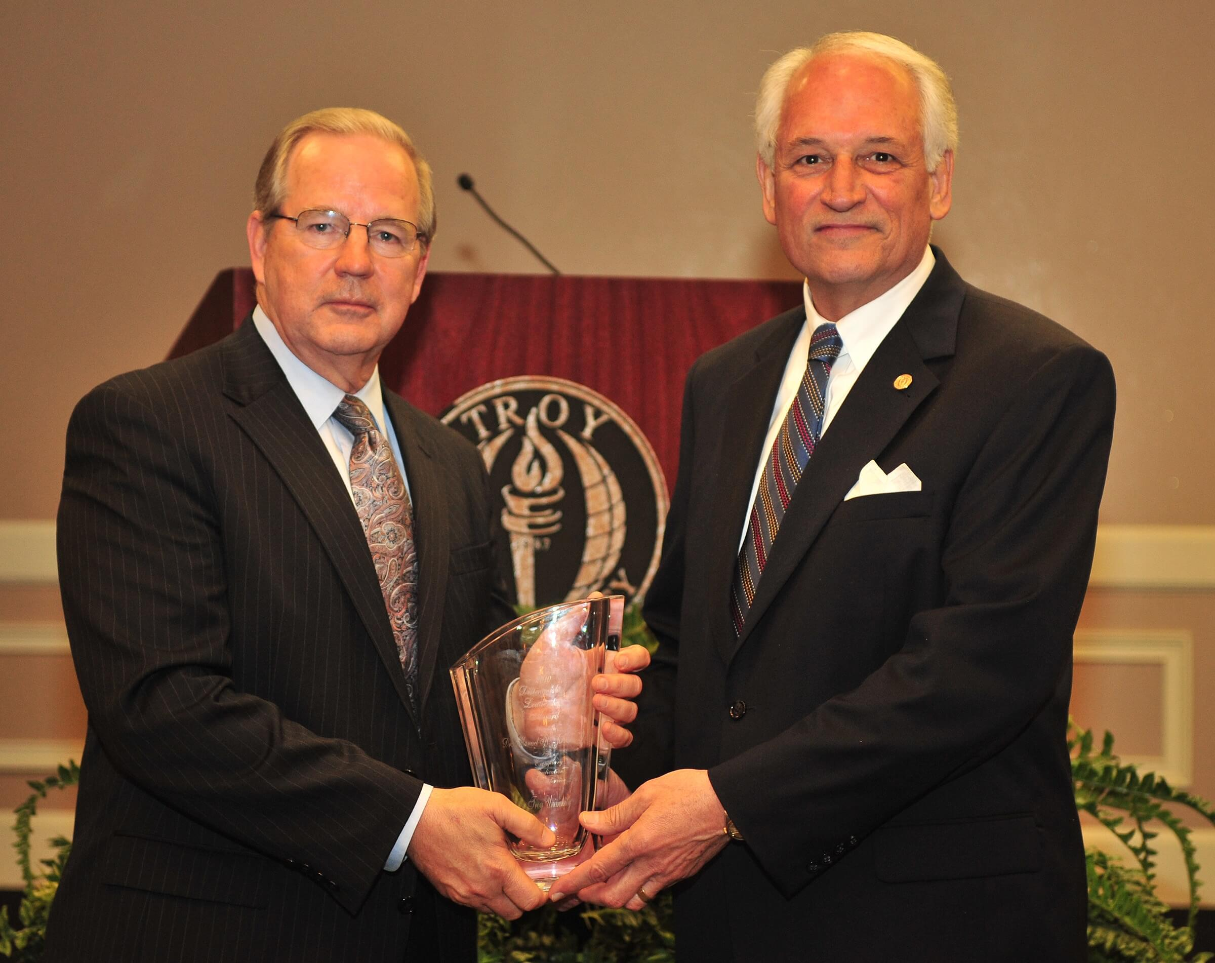 Chancellor Hawkins presents the 2010 Distinguished Leadership Award to Dr. Manley Johnson.