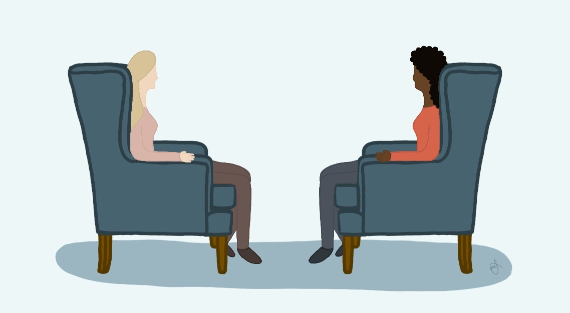 Two women sitting across from each other in arm chairs.