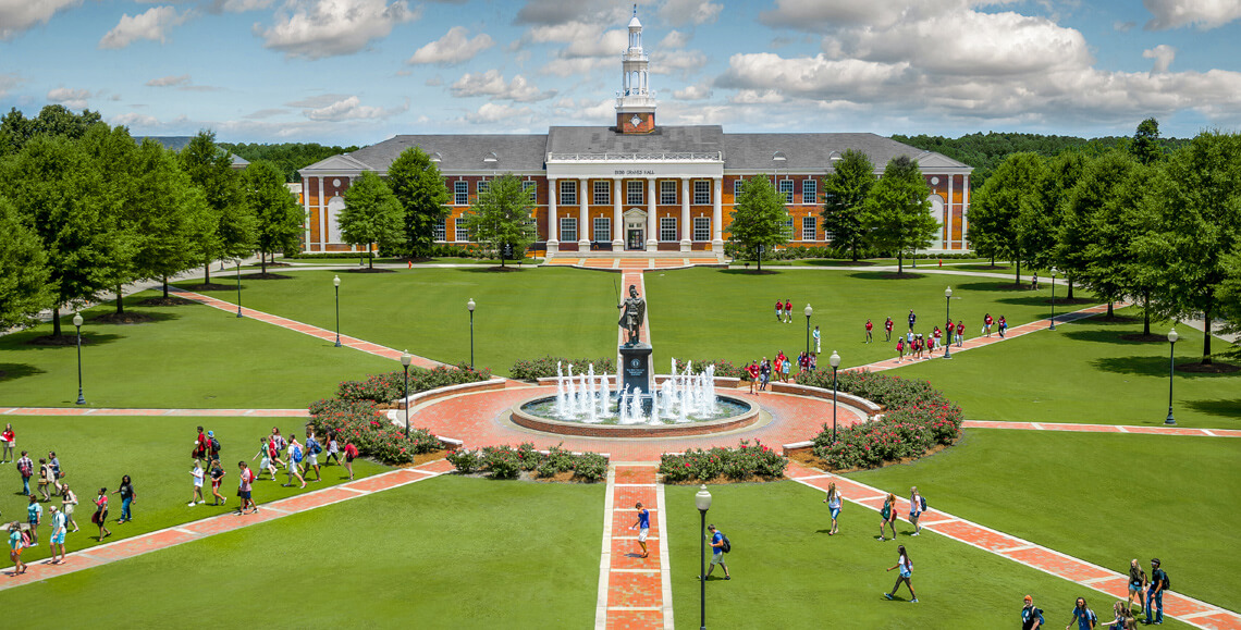 Student walking on the main quad on the Troy, AL campus.