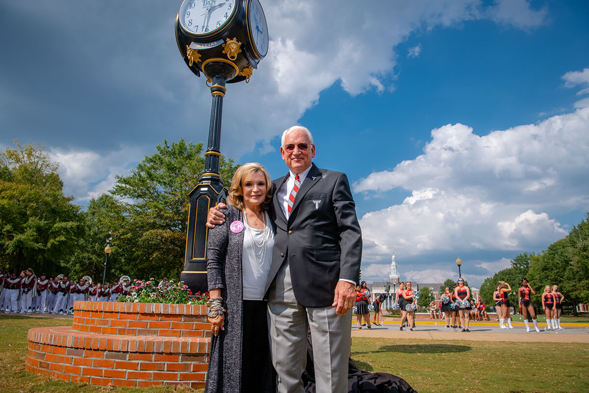 TROY celebrates honoring Dr. Jack Hawkins, Jr for 30 years as Chancellor by situating clock in front of Smith Hall.