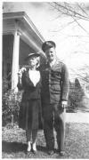 Sgt. William Campbell, standing with older woman (possibly his mother) before home (possibly in Dothan, AL), ca. 1942.