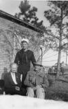 Mike Greer as a sailor in the US Navy pictured with his parents, Levi Washington Greer and <Mother's Name> at the family home in Slocomb, Alabama.