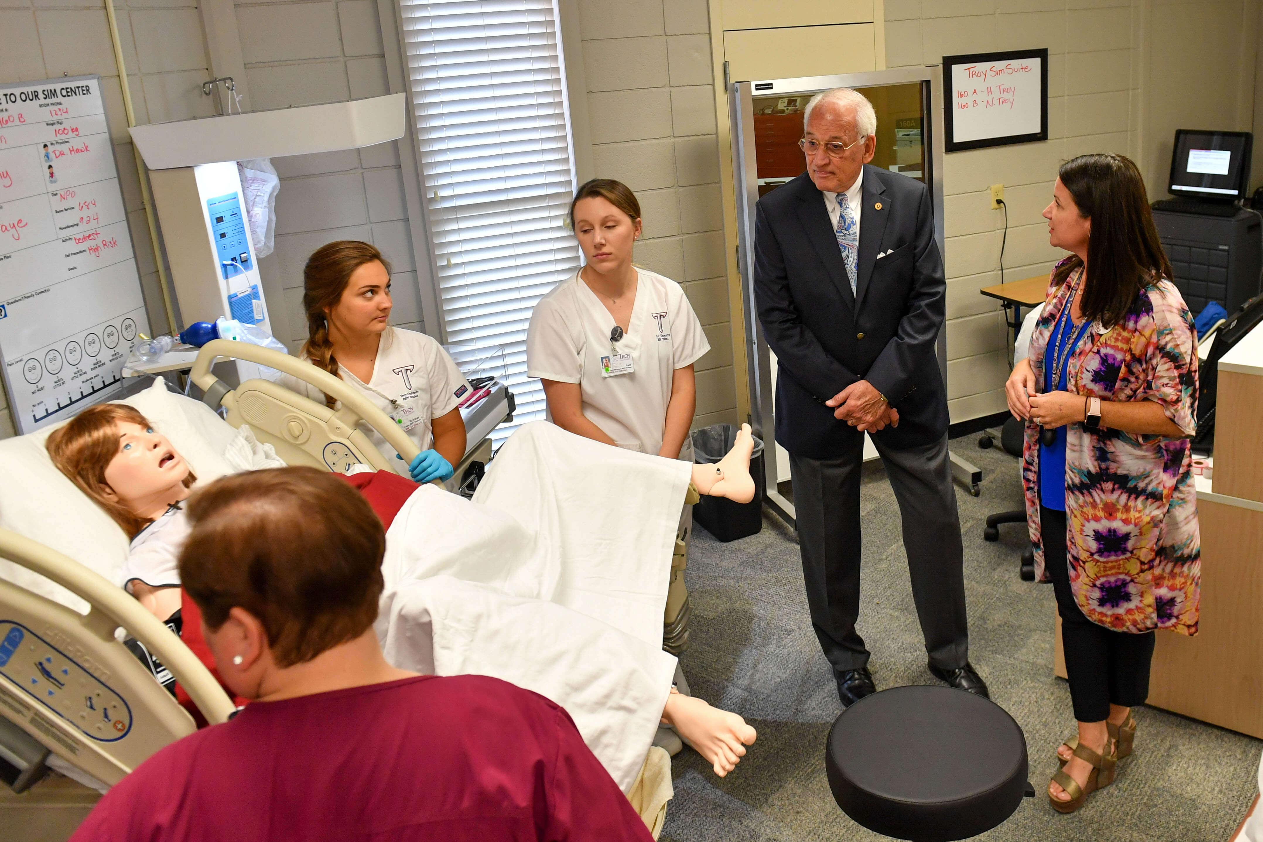 Hawkins, Booth, Davis, and Troy students reviewing simulation equipment