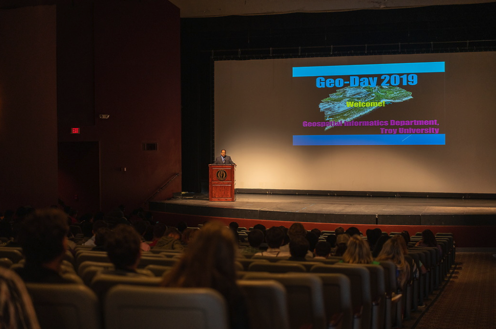 Troy Program director addresses students in opening session of Geo Day 2019 in auditorium