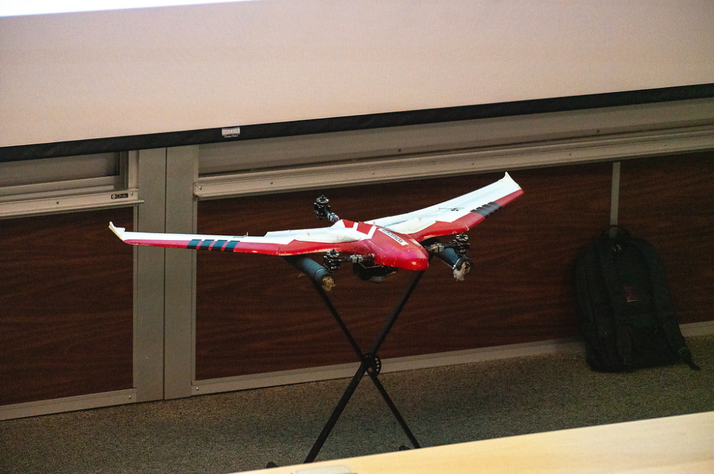 Fixed wing drone with camera on display at a Geo Day session