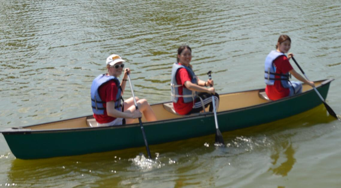 New exchange students canoeing at Camp Butter and Egg during Orientation