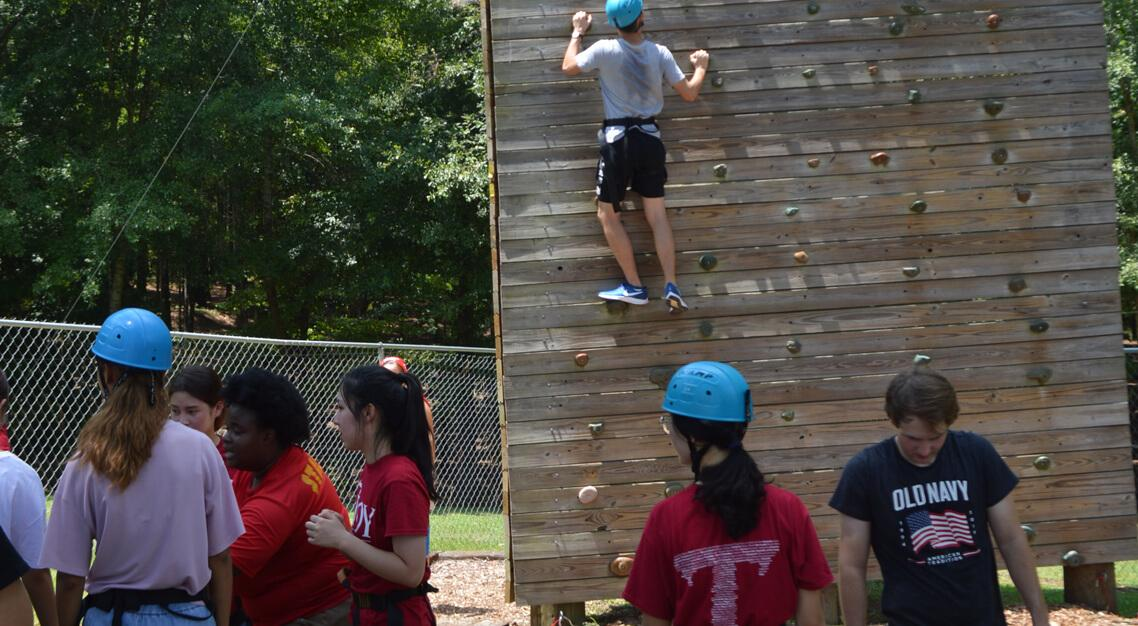 New students climbing the wall at  Camp Butter and Egg during Orientation.