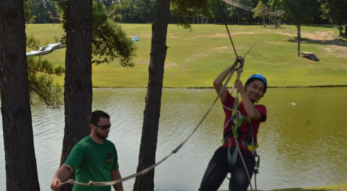 New student on the zipline at Camp Butter and Egg during Orientation.